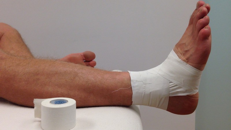 Athletic tape on ankle